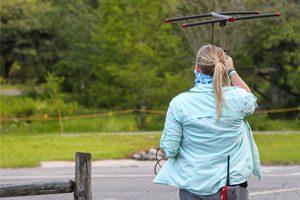 Graduate student Kristen Zemaitis radio-tracking an alligator at Okefenokee Swamp Park.